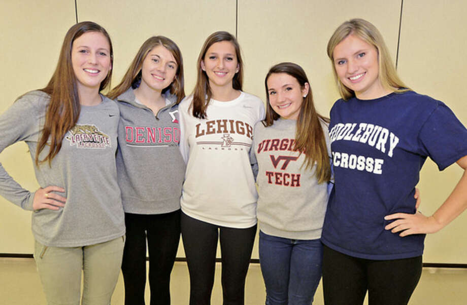 Hour photo/Erik TrautmannStaples High School lacrosse players, from left to right, Amelia Haisler, Nicki Najarian, Samantha Kratky, Paige Murray and Jenna McNicholas signed their national letters of intent to play collge lacrosse Friday.