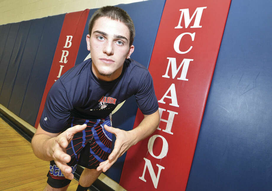 Hour photo/Alex von KleydorffVasili Nikiforides is looking to avenge last season's FCIAC championship loss to Trumbull's Joey Raverta this winter, while McMahon looks to amass its third 10-win season in a row.
