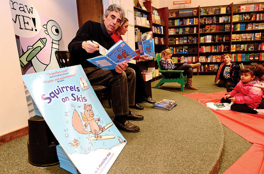 """Hour photo / Erik Trautmann Children's author J. hamilton Ray reads his book, Squirrels on Skis!"""" during the Barnes & Noble and The Norwalk Public Library World of Books book fair Saturday. The book fair continues on Sunday, December 14h and supports Library Programming by donating a percentage of qualifying purchases to The Norwalk Public Library."""