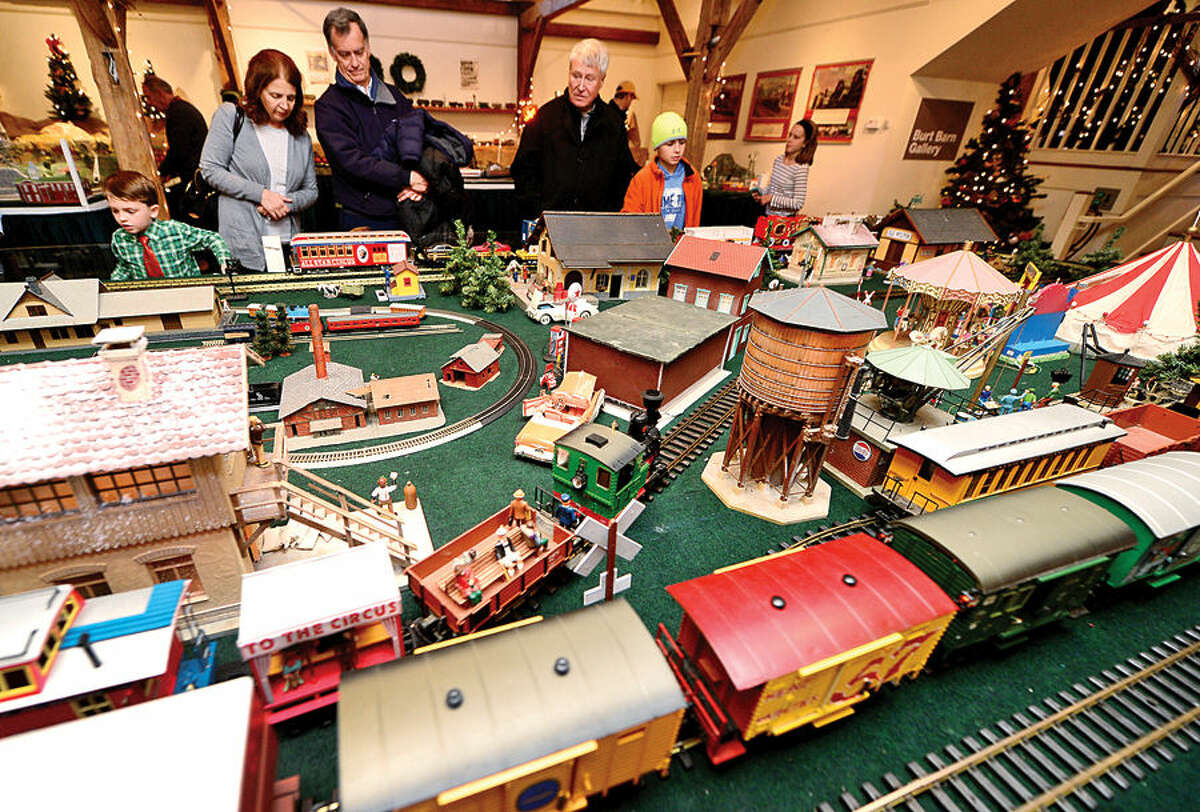 Hour photo / Erik Trautmann Visitors look over The Wilton Historical Society's Holiday Train Exhibit Saturday.