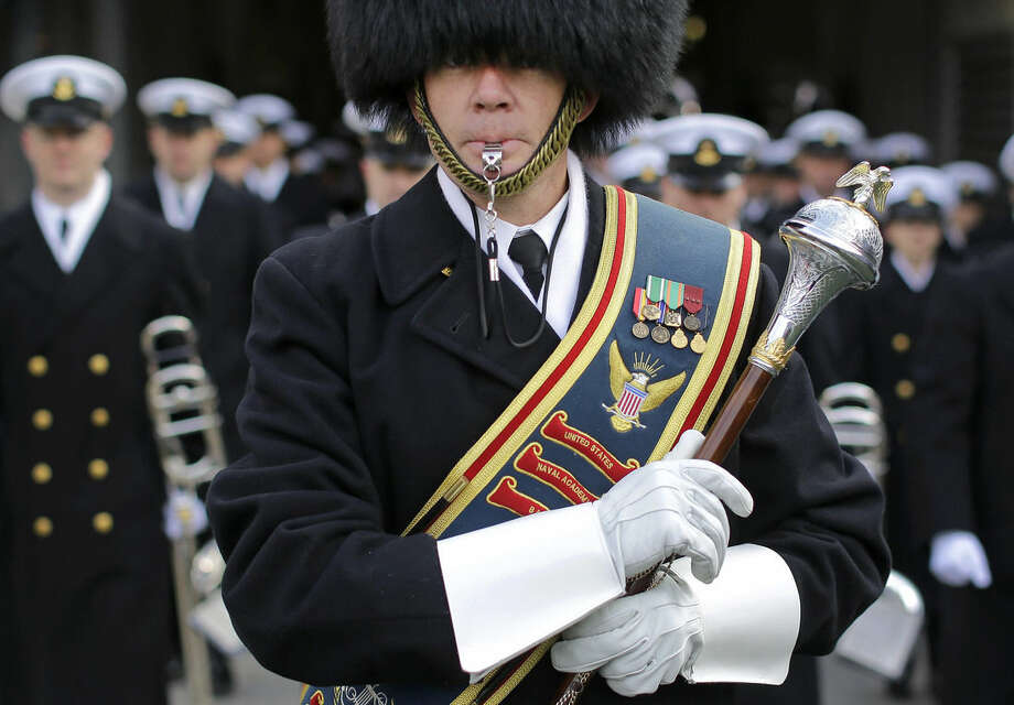 Chief Todd Nix leads the U.S. Naval Academy Band onto the field before the Army-Navy NCAA college football game, Saturday, Dec. 13, 2014, in Baltimore. (AP Photo/Patrick Semansky)