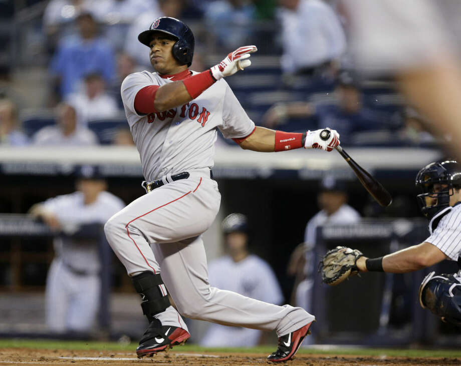 """FILE - In this Sept. 2, 2014, file photo, Boston Red Sox's Yoenis Cespedes watches an RBI double off New York Yankees starting pitcher Shane Greene in a baseball game at Yankee Stadium in New York. Twenty-five Cuban-born players appeared in the major leagues this year, a group that includes outfielders Yasiel Puig and Cespedes, and hard-throwing reliever Aroldis Chapman. Fred Claire can see the day when Major League Baseball teams open academies for prospects in Cuba. """"It's absolutely a natural, just as the Dominican was and Venezuela. You go to where the talent is,"""" the former Los Angeles Dodgers general manager said Wednesday, Dec. 17, 2014. """"The high talent level for Cuban players is still there."""" (AP Photo/Kathy Willens, File)"""