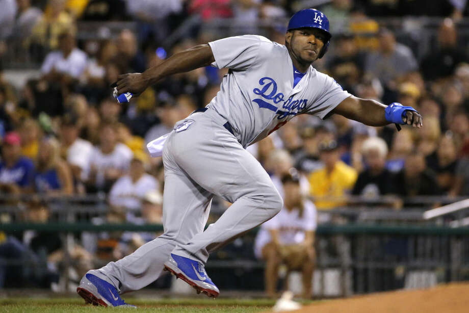"""FILE - In this July 23, 2014, file photo, Los Angeles Dodgers' Yasiel Puig leads off first during a baseball game against the Pittsburgh Pirates in Pittsburgh. Twenty-five Cuban-born players appeared in the major leagues this year, a group that includes outfielders Puig and Yoenys Cespedes, and hard-throwing reliever Aroldis Chapman. Fred Claire can see the day when Major League Baseball teams open academies for prospects in Cuba. """"It's absolutely a natural, just as the Dominican was and Venezuela. You go to where the talent is,"""" the former Los Angeles Dodgers general manager said Wednesday, Dec. 17, 2014. """"The high talent level for Cuban players is still there."""" (AP Photo/File)"""