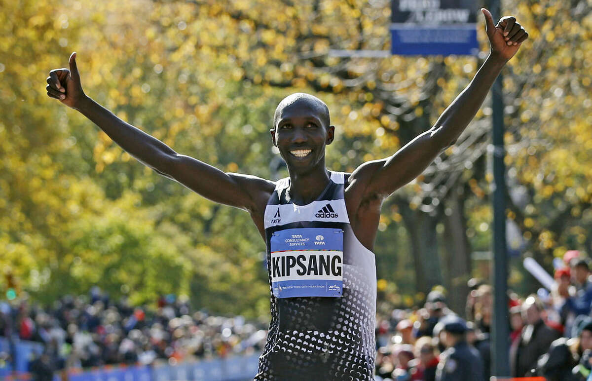 FILE - In this Sunday, Nov. 2, 2014 file photo, Wilson Kipsang of Kenya celebrates on the finish line after winning the men's division of the 44th annual New York City Marathon in New York. Athletics Kenya says former marathon world-record holder Wilson Kipsang missed an out-of-competition doping test in Nov. 2014, but that no sanction will be imposed against Kipsang since it's his first failure to be evaluated. (AP Photo/Kathy Willens, File)