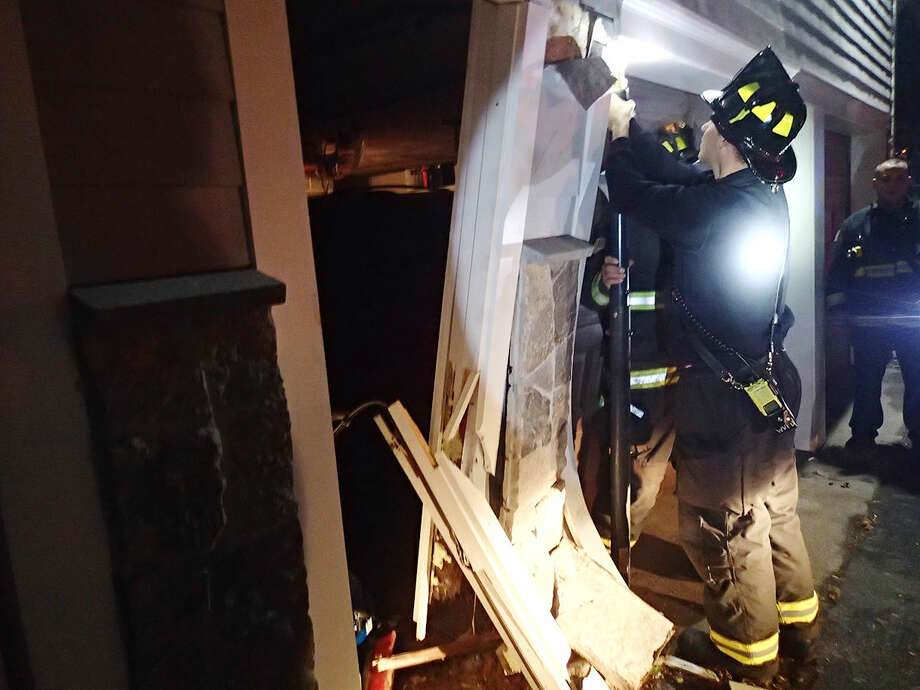 Contributed photoWestport Fire Department responds to a van that struck a residence on Terhune Drive Wednesday evening.