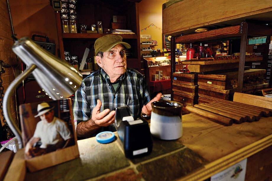 Hour photo / Erik Trautmann Master Cigar roller at the Inetrnational Cigar Factory Outlet and native of Cuba, Alberto Hernandez, comments about the thawing of relations between Cuba and the United States.