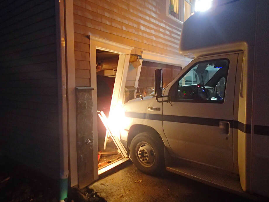 Contributed photo Westport Fire Department responds to a van that struck a residence on Terhune Drive Wednesday evening.