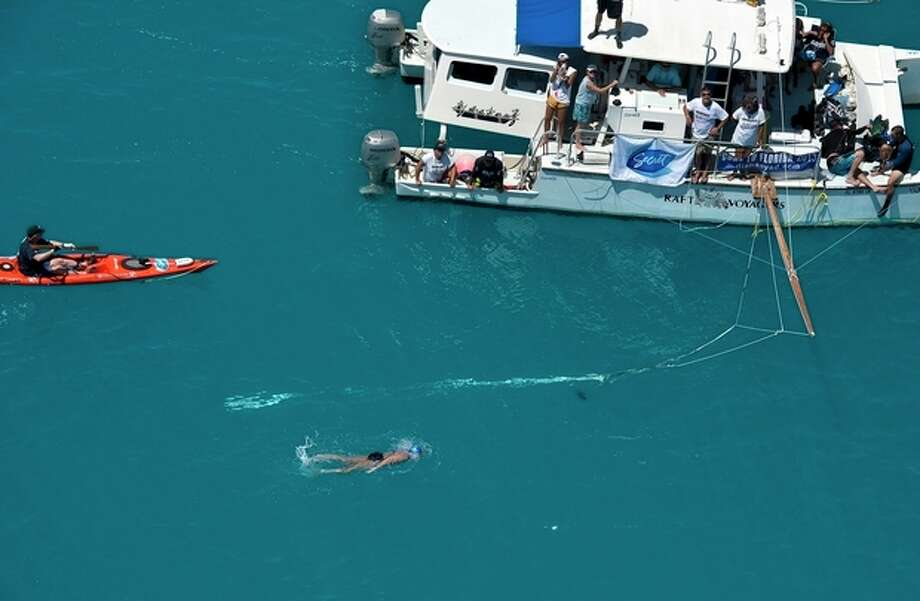 In this photo provided by the Florida Keys News Bureau, Diana Nyad, positioned about two miles off Key West, Fla., Monday, Sept. 2, 2013, swims towards the completion of her approximately 110-mile trek from Cuba to the Florida Keys. Nyad, 64, is the first swimmer to cross the Florida Straits without the security of a shark cage. (AP Photo/Florida Keys News Bureau, Andy Newman) / Florida Keys News Bureau