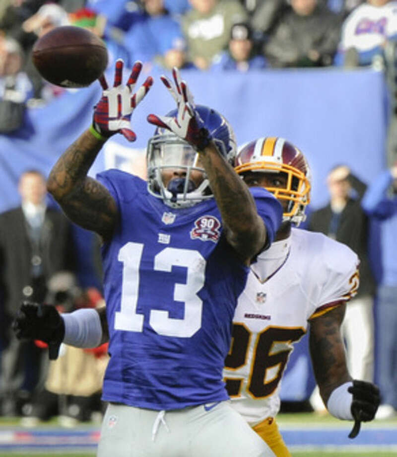 New York Giants wide receiver Odell Beckham (13) makes a catch against Washington Redskins cornerback Bashaud Breeland (26) during the second quarter of an NFL football game, Sunday, Dec. 14, 2014, in East Rutherford, N.J. (AP Photo/Bill Kostroun)