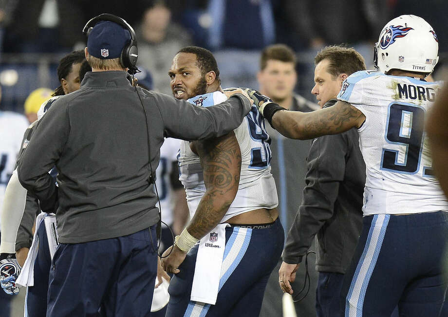 Tennessee Titans defensive end Jurrell Casey (99) looks back toward the field as he is led to the sideline following a fight with New York Jets players in the second half of an NFL football game Sunday, Dec. 14, 2014, in Nashville, Tenn. (AP Photo/Mark Zaleski)