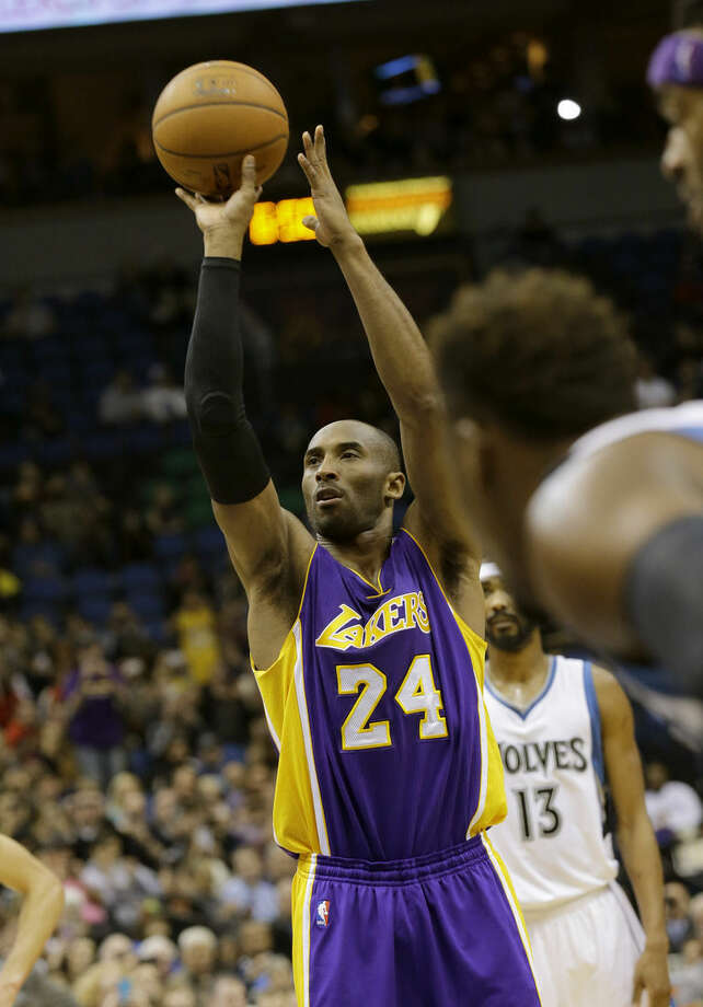 Los Angeles Lakers guard Kobe Bryant (24) shoots a free-throw during the second quarter of an NBA basketball game against the Minnesota Timberwolves in Minneapolis, Sunday, Dec. 14, 2014. Bryant passed Michael Jordan on the NBA all-time scoring list by making the shot. (AP Photo/Ann Heisenfelt)
