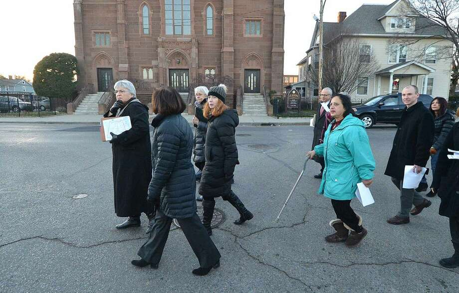 Hour Photo/Alex von Kleydorff Along South Main St, State of Connecticut Deparetment of Energy and Environmental Protection Hearing Officer, Janice Deshais takes a walking tour of the area to be considered for development at Washington Village in SONO