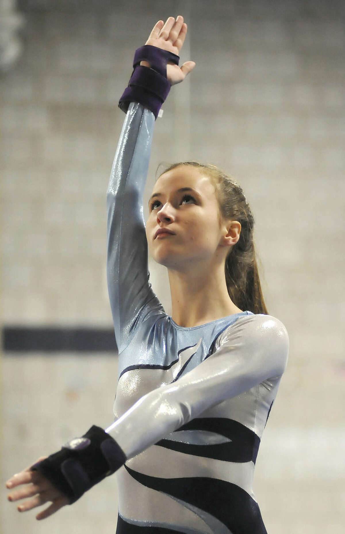 Hour photo/John Nash Wilton's Meredith Nash competes at the FCIAC championships last year. Nash returns to a Warriors squad that expects to contend in a competitive FCIAC.