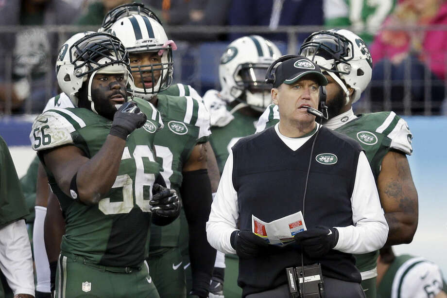 New York Jets head coach Rex Ryan, right, watches from the sideline in the first half of an NFL football game against the Tennessee Titans, Sunday, Dec. 14, 2014, in Nashville, Tenn. (AP Photo/James Kenney)