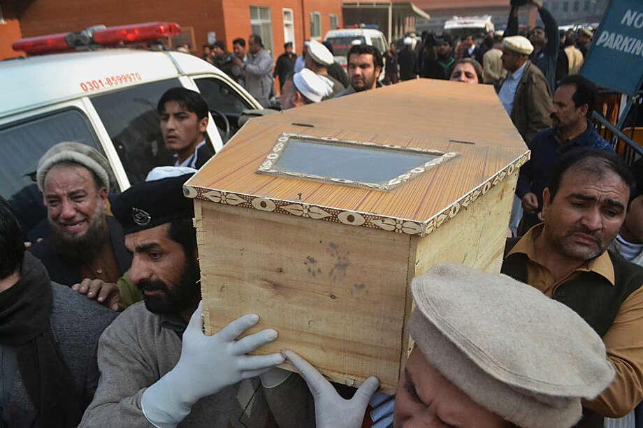 People carry the casket of a victim of Taliban attack in a school, after receiving it from a local hospital in Peshawar, Pakistan, Tuesday, Dec. 16, 2014. Taliban gunmen stormed a military school in the northwestern Pakistani city of Peshawar on Tuesday, killing and wounding dozens, officials said, in the latest militant violence to hit the already troubled region. (AP Photo/Mohammad Sajjad)