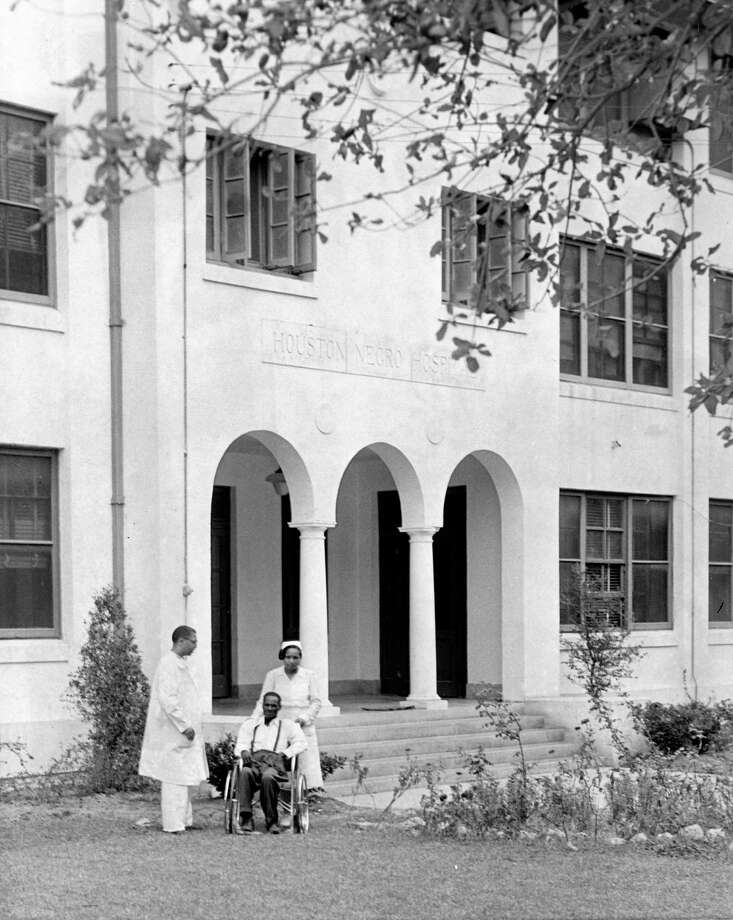 Robert Turner, a patient at Houston Negro Hospital, visits the hospital's spacious lawn in October 1951, accompanied by Dr. J.H. Wells, resident physician, and nurse V.O. Vines. Photo: Stan Begam, HC Staff / Houston Chronicle
