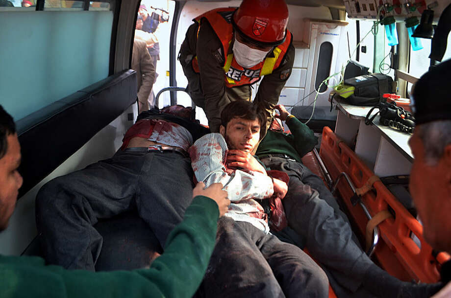 Pakistani rescue workers take out students from an ambulance who injured in the shootout at a school under attack by Taliban gunmen, upon arrival at a local hospital in Peshawar, Pakistan, Tuesday, Dec. 16, 2014. Taliban gunmen stormed a military school in the northwestern Pakistani city, killing and wounding dozens, officials said, in the latest militant violence to hit the already troubled region. (AP Photo/Mohammad Sajjad)