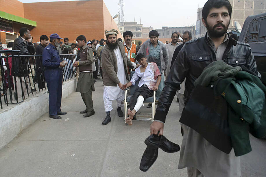 A Pakistani student, who was injured in a Taliban attack in a school, is brought to a hospital in Peshawar, Pakistan, Tuesday, Dec. 16, 2014. Taliban gunmen stormed a military-run school in the northwestern Pakistani city of Peshawar on Tuesday, killing and wounding scores, officials said, in the highest-profile militant attack to hit the troubled region in months.(AP Photo/Mohammad Sajjad)