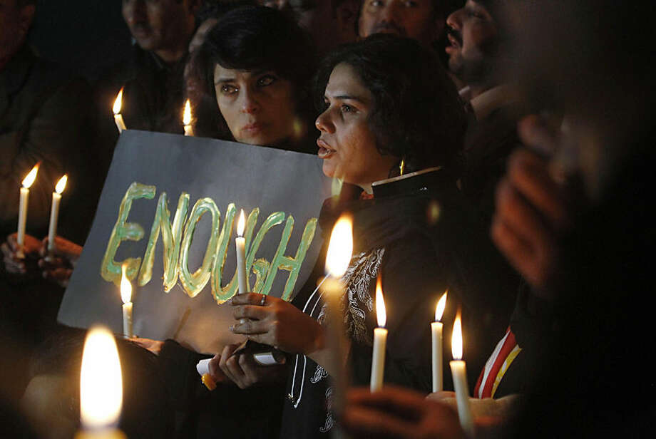 Pakistani civil society members take part in a candle light vigil for the victims of a school attacked by the Taliban in Peshawar, Tuesday, Dec. 16, 2014 in Islamabad, Pakistan. Taliban gunmen stormed a military-run school in the northwestern Pakistani city, killing more than 100 people, officials said, in the worst attack to hit the country in years.(AP Photo/Anjum Naveed)