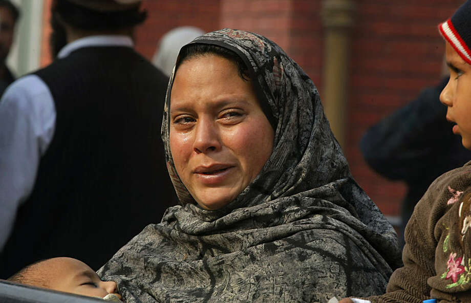 A Pakistani woman weeps as she waits at a hospital, where victims of a Taliban attack are being treated in Peshawar, Pakistan,Tuesday, Dec. 16, 2014. Taliban gunmen stormed a military-run school in the northwestern Pakistani city of Peshawar on Tuesday, killing and wounding scores, officials said, in the highest-profile militant attack to hit the troubled region in months.(AP Photo/Mohammad Sajjad) (AP Photo/Mohammad Sajjad)