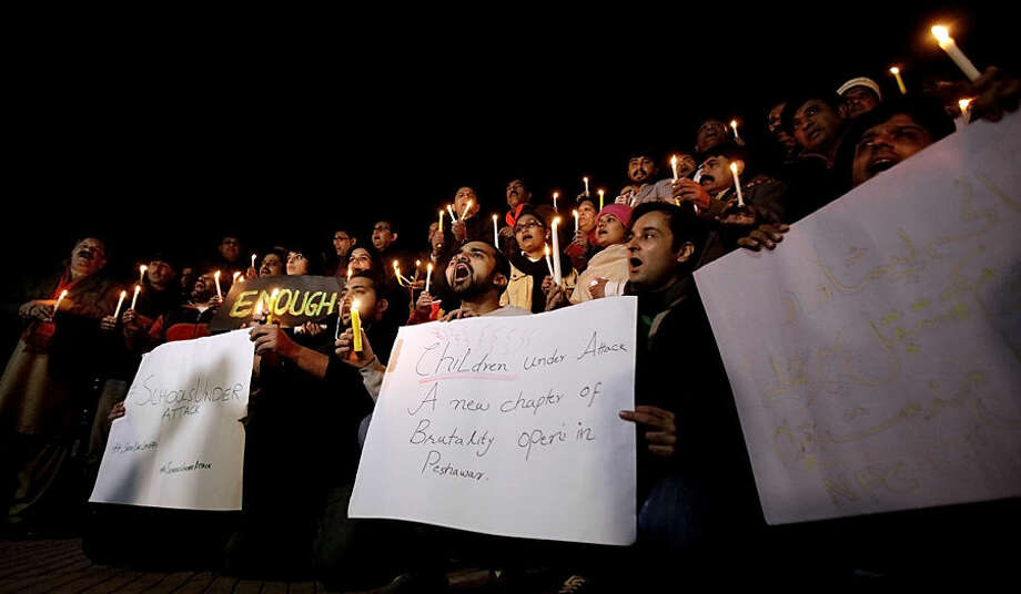 Pakistani journalists and civil society members hold a candle light vigil for the victims of a Taliban attack on a school, in Islamabad, Pakistan, Tuesday, Dec. 16, 2014. Taliban gunmen stormed a military-run school in the northwestern Pakistani city of Peshawar on Tuesday, killing more than 100, officials said, in the highest-profile militant attack to hit the troubled region in months. (AP Photo/Anjum Naveed)