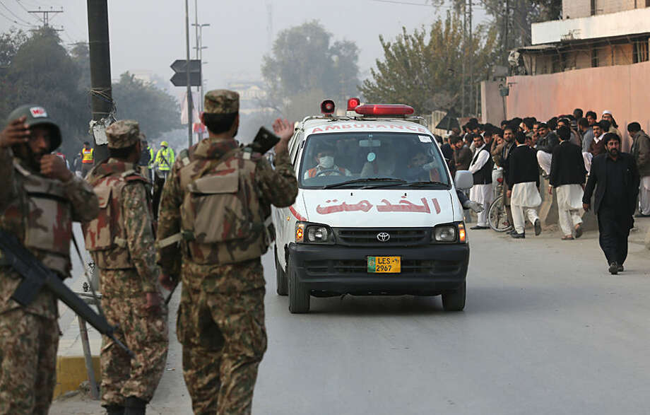 Ambulances carry injured people outside a school attacked by the Taliban in Peshawar, Pakistan, Tuesday, Dec. 16, 2014. Taliban gunmen stormed a military-run school in the northwestern Pakistani city of Peshawar on Tuesday, killing and wounding scores, officials said, in the highest-profile militant attack to hit the troubled region in months. (AP Photo/B.K. Bangash)