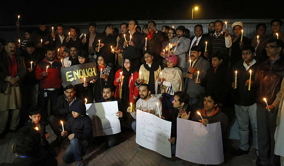 Pakistani civil society members take part in a candle light vigil for the victims of a Taliban attack on a school in Peshawar, Tuesday, Dec. 16, 2014 in Islamabad, Pakistan. Taliban gunmen stormed a military-run school in the northwestern Pakistani city, killing more than 100 people, officials said, in the worst attack to hit the country in years.(AP Photo/Anjum Naveed)(AP Photo/Anjum Naveed)