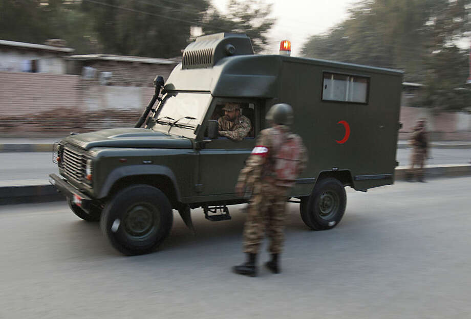 A Pakistan army ambulance rushes injured people to a hospital outside a school attacked by Taliban in Peshawar, Pakistan, Tuesday, Dec. 16, 2014. Taliban gunmen stormed a military-run school in the northwestern Pakistani city of Peshawar on Tuesday, killing and wounding scores, officials said, in the highest-profile militant attack to hit the troubled region in months. (AP Photo/B.K. Bangash)