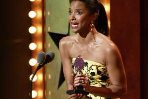 "Renee Elise Goldsberry accepts the award for featured actress in a musical for ""Hamilton""  at the Tony Awards at the Beacon Theatre on Sunday, June 12, 2016, in New York. (Photo by Evan Agostini/Invision/AP)"