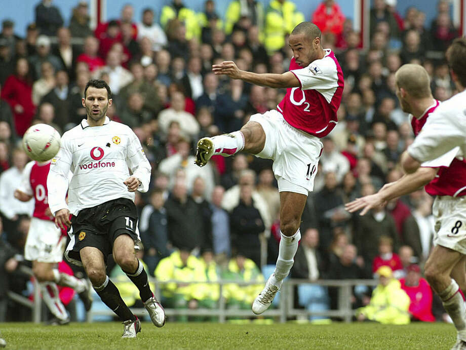 FILE - In this Saturday April 3, 2004 file photo Arsenal's Thierry Henry, second from left, shoots for a goal minutes after he came on in the second half of the FA Cup semi-Final between Manchester United and Arsenal at Villa Park, Birmingham, England. Thierry Henry has announced his retirement following a 20-year career. The 37-year-old Henry, a member of the France teams that won the 1998 World Cup and 2000 European Championship, will take up a media role as a consultant for Sky Sports channel. (AP Photo/John D McHugh, File)