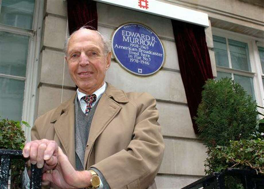 """FILE - In this Feb. 15, 2006 file photo, An English Heritage Blue Plaque is unveiled for American broadcaster Edward R. Murrow by fellow reporter Richard C. Hottelet at Weymouth House, Hallam Street, in London, where he lived from 1938-1946 during the blitz. Hottelet, the last of the original """"Murrow's Boys,"""" the pioneering group of wartime journalists hired by CBS radio newsman Edward R. Murrow, has died. He was 97. CBS News spokesman Kevin Tedesco said Wednesday, Dec. 17, 2014, that Hottelet died Tuesday night, Dec. 16, at his home in Connecticut."""