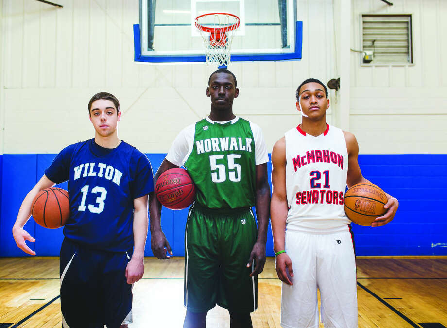 AAU teammates, from left to right, Matt Shifrin of Wilton, Roy Kane Jr of Norwalk and Timmy Hinton Jr of McMahon, are all leading players for their respective high school teams as boys high school basketball play begins across the state of Connecticut this week.