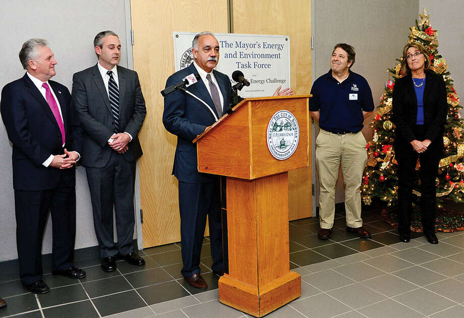 Hour photo / Erik Trautmann Norwalk Mayor Harry Rilling, John Kydes, Coucilman and Chair of Mayor's Energy and Environmental Task Force listen and Norwalk Public School Superintendent Manuel Rivera announce the newly formed Mayor's Student Engineering & Science program during a press conference with Marimte Aquarium Director of Education Thomas Naiman and NPS Science Coordinator Tamre Mockus at City Hall Thursday morning. The Mayor's Student Engineering & Science program also received a check for $10,000 from New England Smart Energy and Next Step Living.