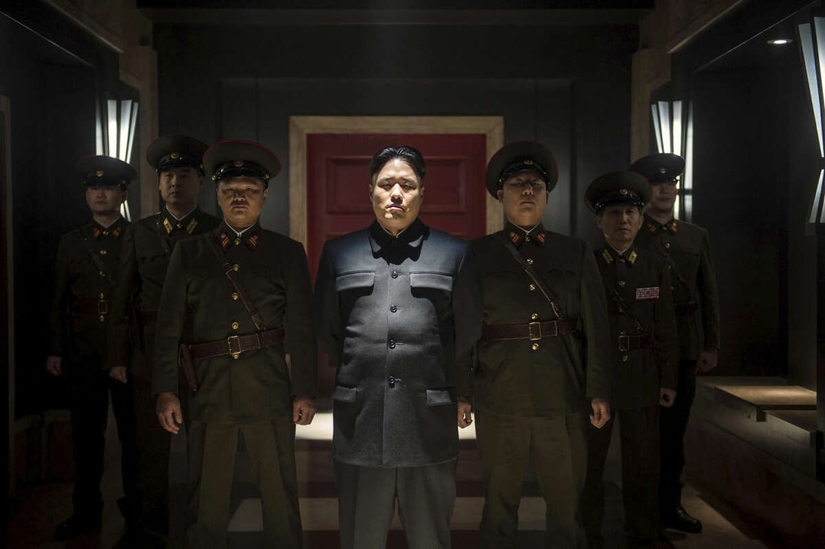 In this undated photo provided by Columbia Pictures - Sony, Actor Randall Park, center, portrays North Korean leader Kim Jong Un in Columbia Pictures'
