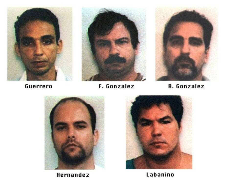 "FILE - This file photo of images provided by the FBI shows Antonio Guerrero, Fernando Gonzalez, Rene Gonzalez, Gerardo Hernandez and Ramon Labanino, who are known as the ""Cuban Five."" The men were intelligence agents operating in Florida in the 1990s, and were arrested in 1998 and later convicted on charges including conspiracy and failing to register as foreign agents. On Wednesday, Dec. 17, 2014, the United States and Cuba agreed to re-establish diplomatic relations and open economic and travel ties. As a confidence-building measure, Guerrero, Hernandez and Labanino are expected to be released from federal prison in Butner, N.C. (AP Photo/FBI, File)"