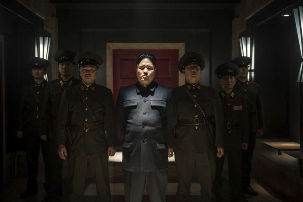 AP Photo/Columbia Pictures - Sony, Ed Araquel This photo provided by Columbia Pictures - Sony shows, Randall Park, center, as Kim Jong Un in Columbia Pictures'