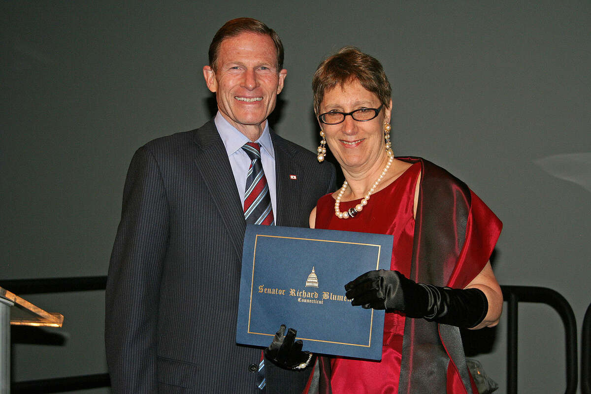 Contributed photo Sen. Richard Blumenthal presents a proclamation to Jennifer Herring celebrating her 10 years as president of The Maritime Aquarium.