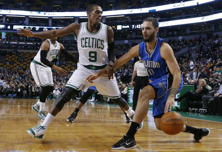 Orlando Magic guard Evan Fournier (10) drives against Boston Celtics guard Rajon Rondo (9) during the first half of an NBA basketball game in Boston, Wednesday, Dec. 17, 2014. (AP Photo/Elise Amendola)