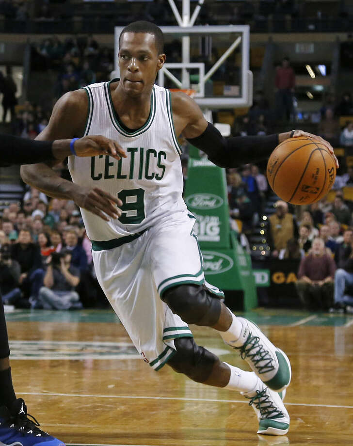 In this Wednesday, Dec. 17, 2014 photo, Boston Celtics guard Rajon Rondo (9) drives during the second half of an NBA basketball game against the Orlando Magic in Boston. The Celtics traded point guard Rajon Rondo to Dallas on Thursday night, Dec. 18, 2014, cutting ties with the last remnant of Boston's last NBA championship while giving Dirk Nowitzki and the Mavericks a chance at another title. (AP Photo/Elise Amendola)