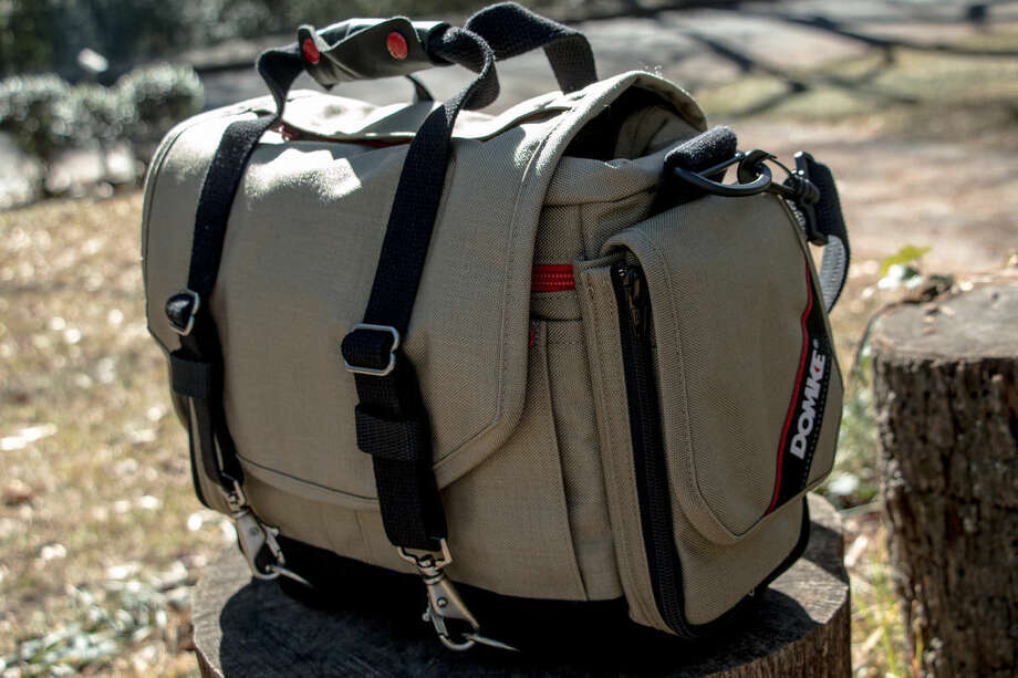 This Dec. 16, 2014 photo shows the Domke Next Generation Director photography bag, in Decatur, Ga. The Domke Director has rugged expandable zippered pockets and customizable divider panels on the interior. (AP Photo/Ron Harris)