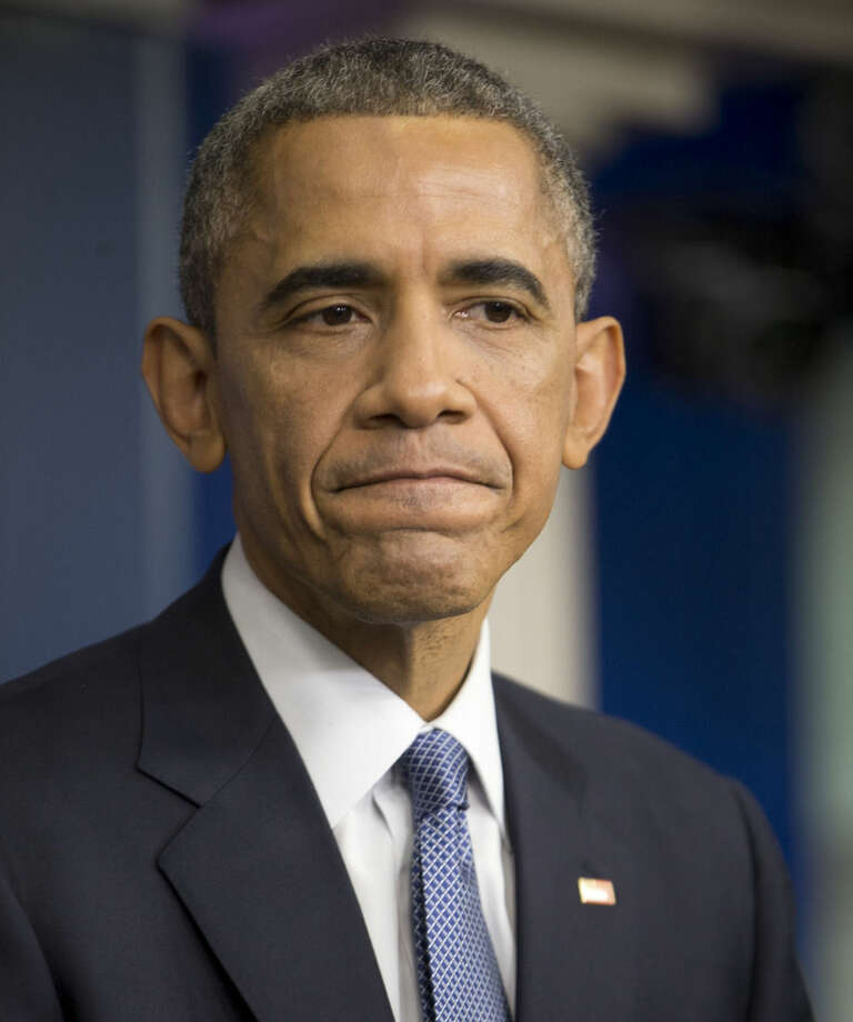 President Barack Obama listens to a question during a news conference in the Brady Press Briefing Room of the White House in Washington, Friday, Dec. 19, 2014. The president claimed an array of successes in 2014, citing lower unemployment, a rising number of Americans covered by health insurance, and an historic diplomatic opening with Cuba. He also touts his own executive action and a Chinese agreement to combat global warming. (AP Photo/Pablo Martinez Monsivais )