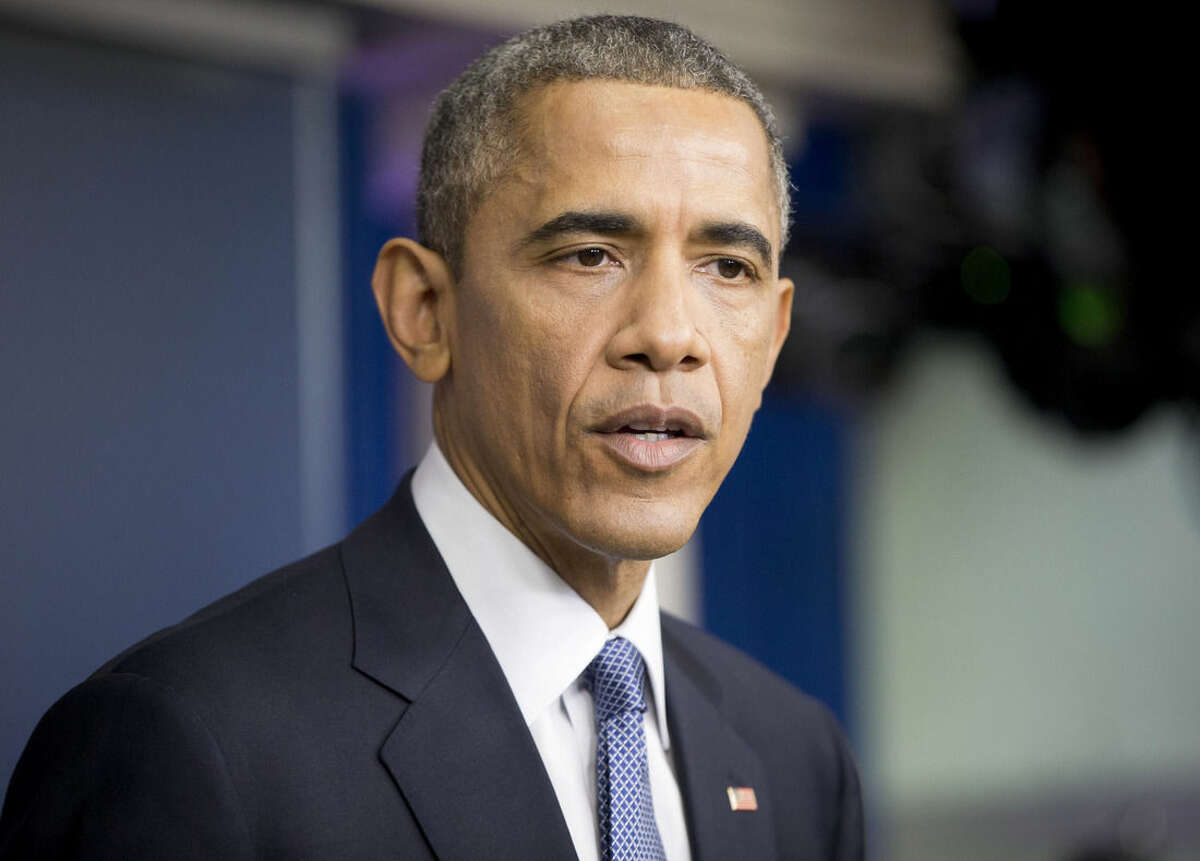President Barack Obama speaks during a news conference in the Brady Press Briefing Room of the White House in Washington, Friday, Dec. 19, 2014. The president said the US is making significant strides where it counts, beginning with the economy. (AP Photo/Pablo Martinez Monsivais )