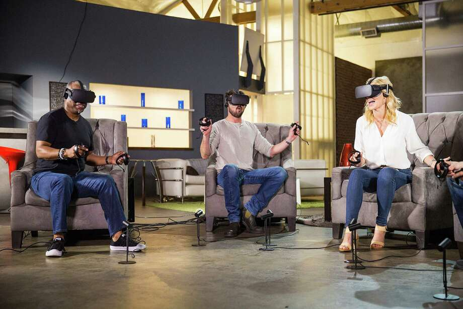 "This undated photo provided by Ubisoft & Celebrity Pre-E3 shows ""Star Trek"" stars Karl Urban, Jeri Ryan and LeVar Burton trying out a mission from ""Star Trek: Bridge Crew,"" the sci-fi franchise's first-ever virtual reality game. ""Bridge Crew"" will be unveiled Monday, June 13, 2016 at the Electronic Entertainment Expo (Ubisoft & Celebrity Pre-E3 via AP)  ORG XMIT: NY112 / Ubisoft & Celebrity Pre-E3"