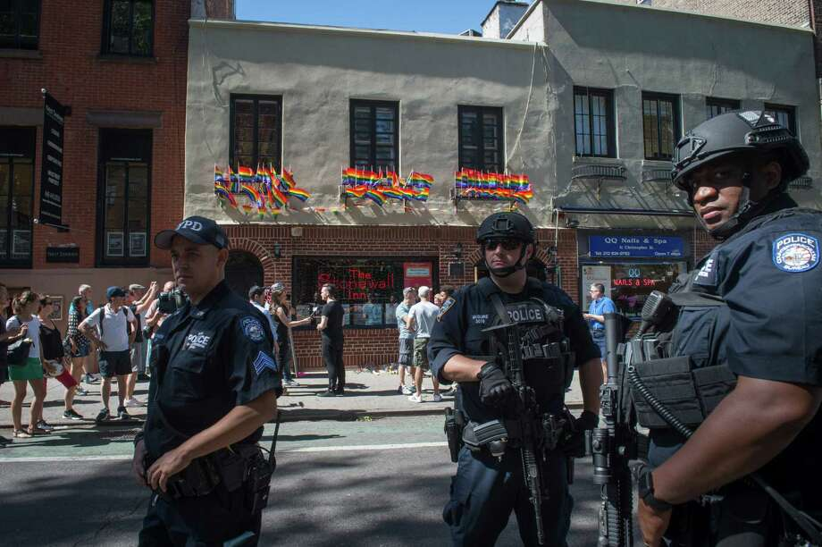 In reaction to the mass shooting at a gay nightclub in Orlando, Florida  members of the NYPD Counterterrorism Unit stand outside the Stonewall Inn near a vigil for the victims in New York on June 12, 2016.  Fifty people died Sunday when a gunman allegedly inspired by the Islamic State group opened fire inside a gay nightclub in Florida, in the worst terror attack on US soil since September 11, 2001. / AFP PHOTO / Bryan R. SmithBRYAN R. SMITH/AFP/Getty Images Photo: BRYAN R. SMITH / AFP or licensors