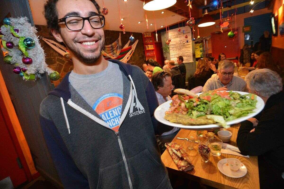 Hour Photo/Alex von Kleydorff Server Justin Hill with a Cerviche Combo at Valencia Luncheria