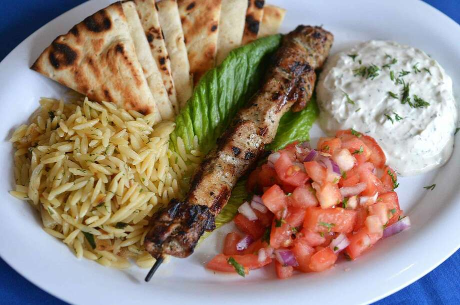 Hour Photo/Alex von Kleydorff Souvlaki Platter at Pontos with Orzo, Pita, tzatziki sauce, and fresh tomatoes
