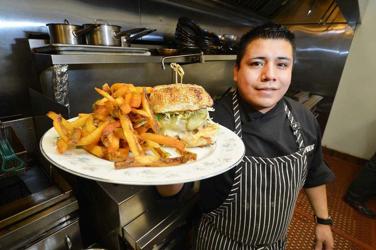 Hour Photo/Alex von Kleydorff Executive Chef Carlos Baez presents the Cheeseburger made with grass fed Kobe beef, cheddar, spicy mayo and served with french fries at The Spread in South Norwalk