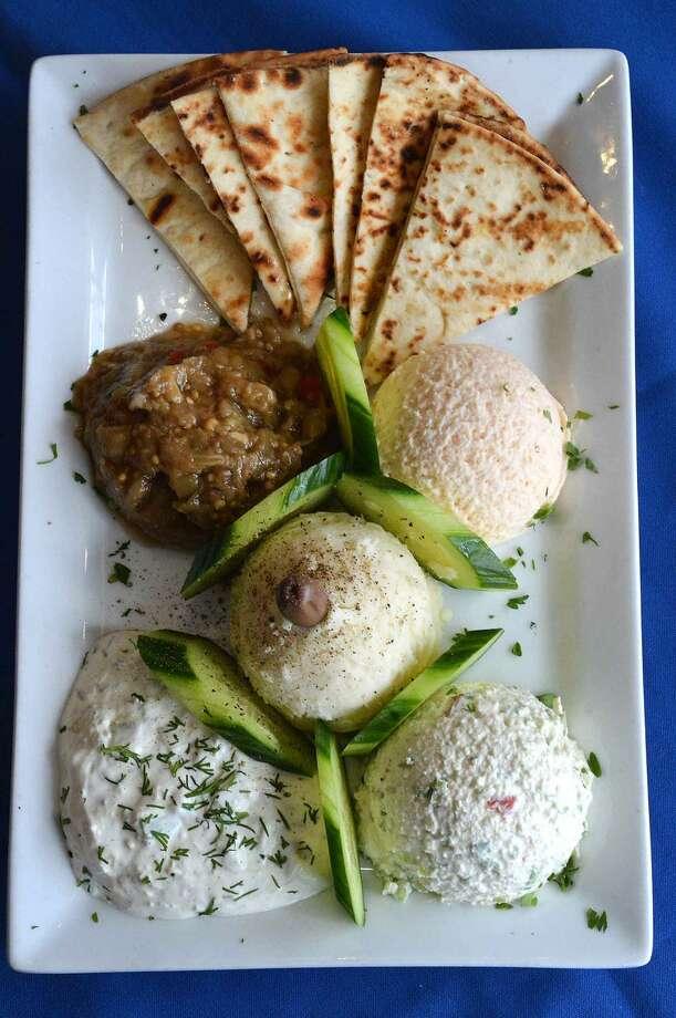Hour Photo/Alex von Kleydorff An asssortment of appetizers served with pita and fresh cucumbers at Pontos Taverna