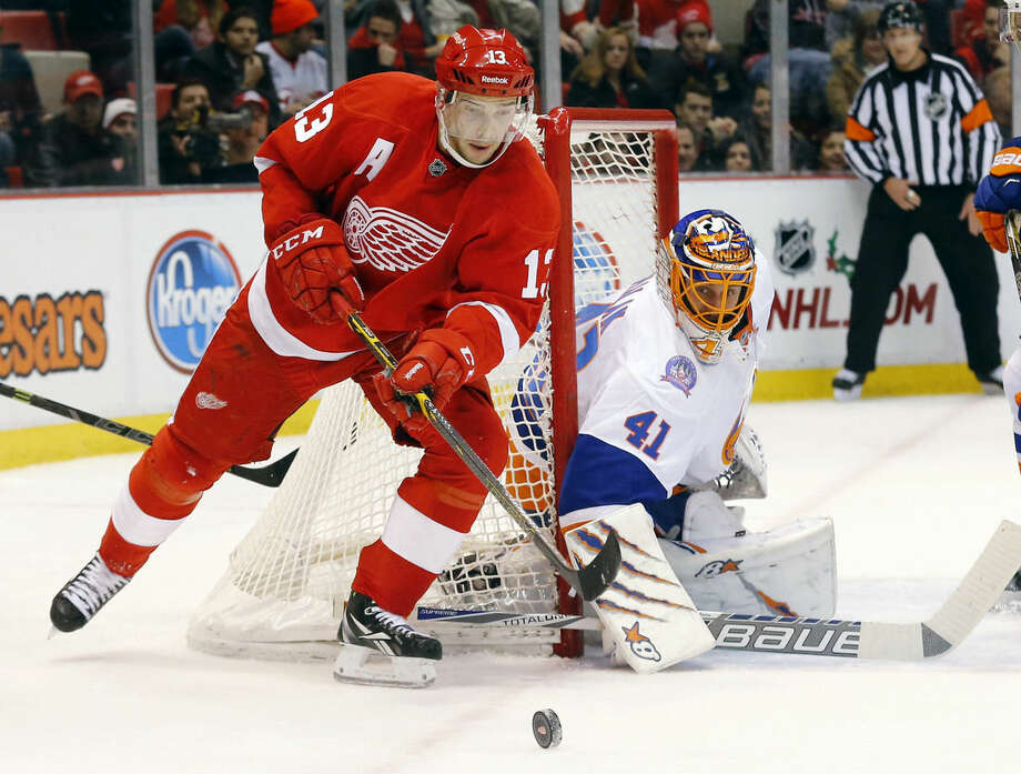 Detroit Red Wings center Pavel Datsyuk (13) skates around New York Islanders goalie Jaroslav Halak (41) during the second period of an NHL hockey game in Detroit Friday, Dec. 19, 2014. (AP Photo/Paul Sancya)