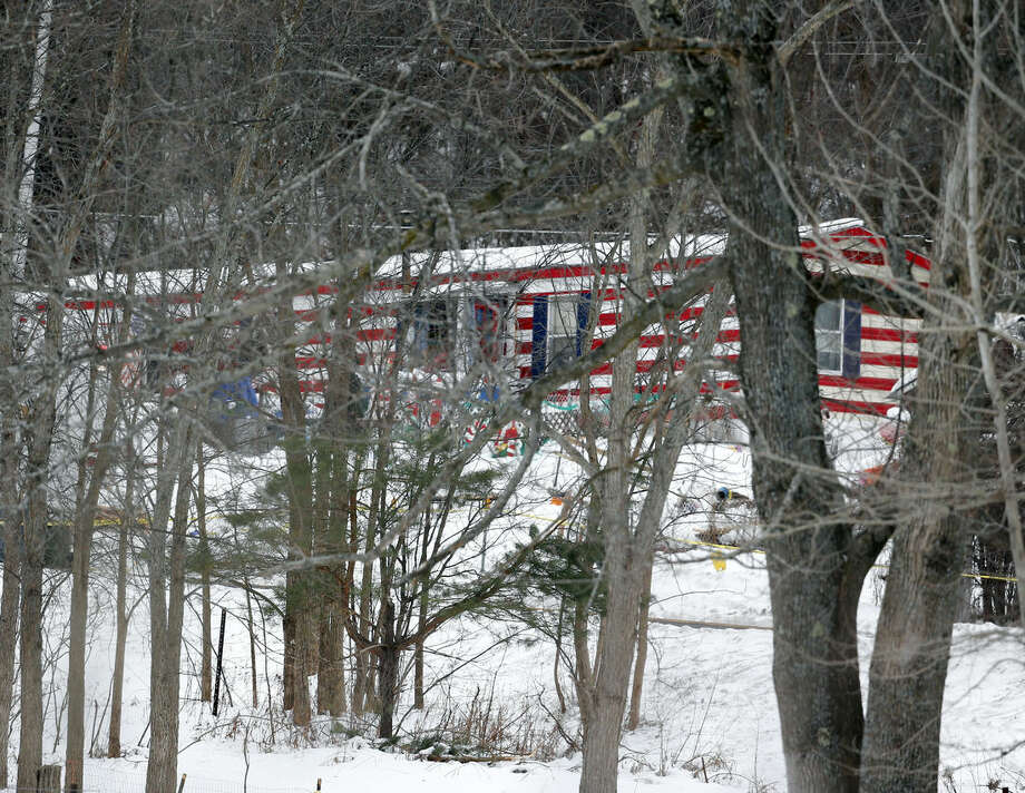 The home where a 5-year-old boy was abducted on Thursday is seen through trees on Friday, Dec. 19, 2014, in Berne, N.Y. Albany County Sheriff Craig Apple told local media at about 3 a.m. Friday that the body of Kenneth White was found by a sheriff's K-9 unit conducting a search in the rural hamlet of Clarksville, 10 miles southwest of Albany. No other details have been released. (AP Photo/Mike Groll)